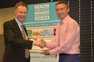 Dr Ian Scott collecting his award